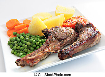Grilled marinated lamb chops meal - A meal of grilled...