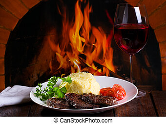 grilled meat and glass of wine
