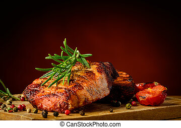 Grilled meat and rosemary - still life with grilled meat and...