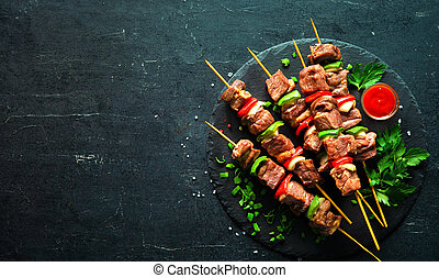 Grilled meat and vegetables on skewers