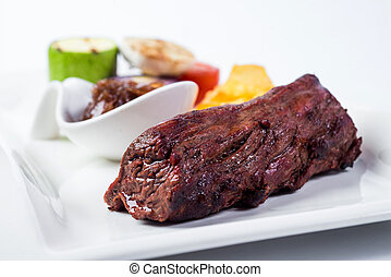 Grilled Meat And Vegetables On White Plate