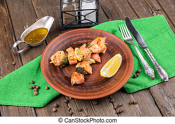 Grilled meat and vegetables on wooden background