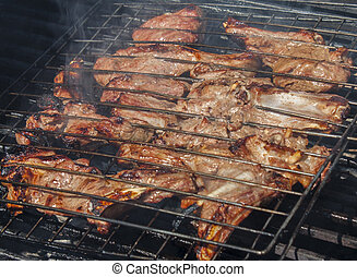 Grilled meat in special fixture.