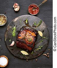 Grilled meat on dark background