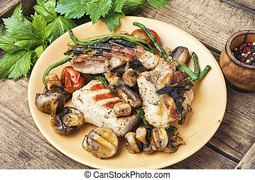 Grilled meat on rustic wooden table