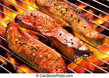 Grilled meat on the flaming grill