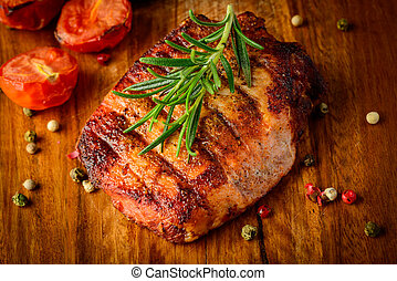 Grilled meat on wooden plate