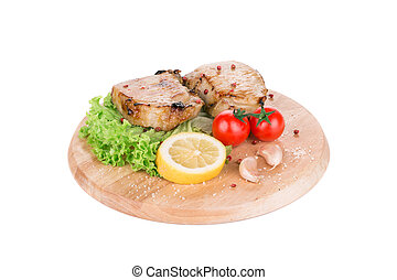 Grilled meat on wooden platter.