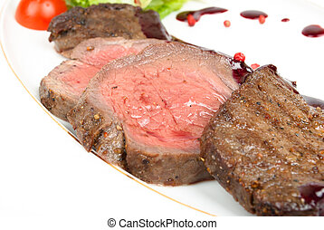 Grilled meat sliced on a plate