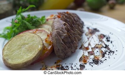 Grilled meat steak with fried potatoes on white plate close up. Food composition sliced meat bbq with vegetable garnish on plate. Food design in high cuisine. Barbecue restaurant menu.
