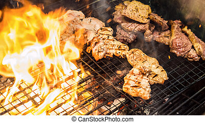 grilled meat - Assorted delicious grilled meat over the...