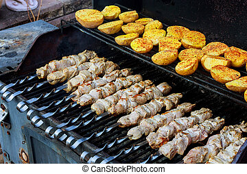 Grilled meat with fried potatoes and meat as well as kebabs