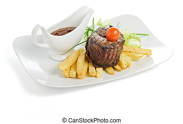 Grilled meat with fries and sauce
