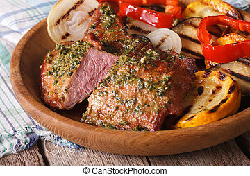 Grilled meat with pesto and vegetables close-up. Horizontal