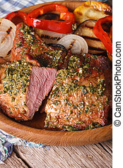 Grilled meat with pesto and vegetables close-up. vertical