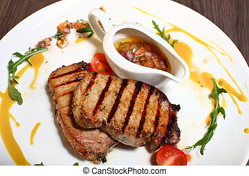 grilled meat with rosemary on wooden background.
