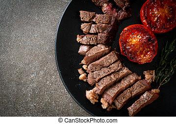Grilled medium rare beef steak