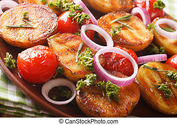 Grilled new potatoes and tomatoes macro on a plate. horizontal