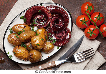 Grilled octopus with small potatoes