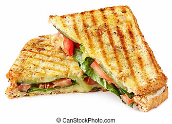 Grilled sandwich or panini with melting cheese, tomato, and spinach leaves, on wholewheat bread.