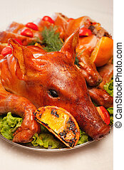 Grilled pig on a plate