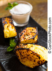Grilled pineapple - pineapple slices grilled. served with ...
