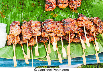grilled pork and sticky rice in thailand