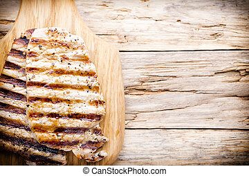 Grilled pork chops pieces. Spices and rosemary.