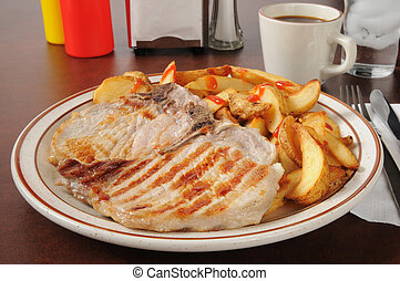 Grilled pork chops with home fries