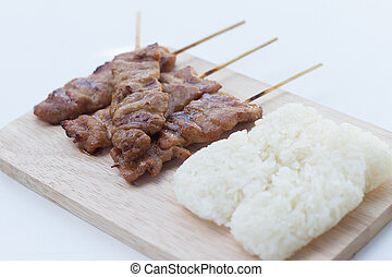Grilled pork in asian style sticky rice