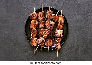 Grilled pork kebabs, top view