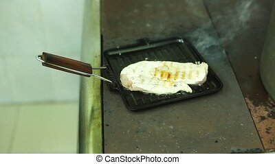 Grilled pork loin and chicken breast steaks on an electric...