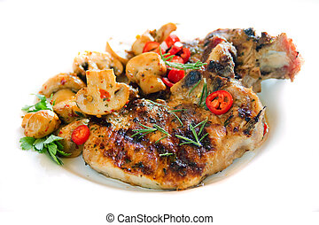 Grilled pork loin chops with mushrooms isolated on white