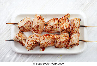grilled pork meat on white plate, pork barbecue