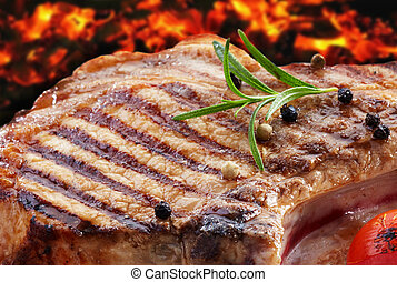 grilled pork meat on red coal background