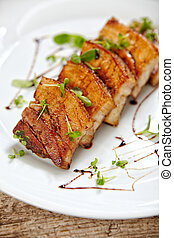 grilled pork on white plate, restaurant portion