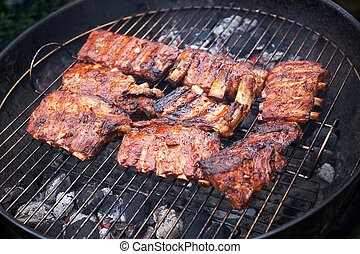 grilled pork ribs on bbq grill (shallow DOF)