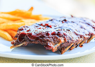 Grilled pork ribs. With tomato sauce