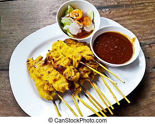 Grilled pork satay with peanut sauce and toast, Thai food
