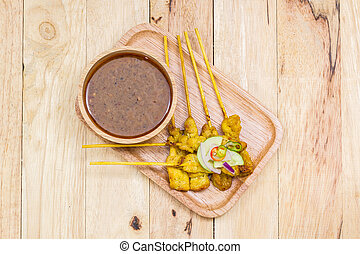 Grilled pork satay with peanut sauce, Traditional Thai barbecue roasted pork.