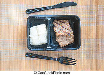 grilled pork served with sticky rice in box