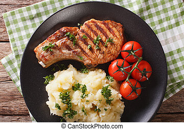Grilled pork steak with mashed potatoes close-up. horizontal top view