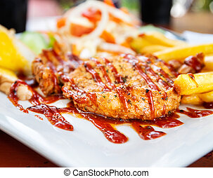 Grilled pork steak with salad on a plate