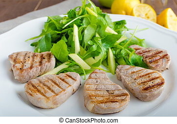 Grilled pork tenderloin with a salad of arugula, honey and...