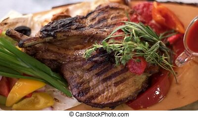Grilled pork with vegetables. Thyme, rosemary and green...