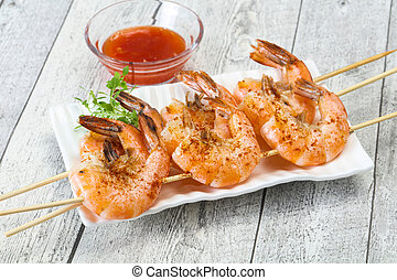 Grilled prawn skewer with sauce