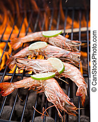grilled prawns - Grilled prawns on flaming grill.