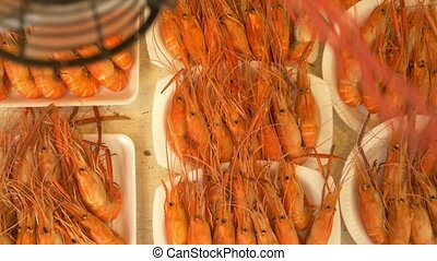 grilled prawns on the counter of the street market, a device...