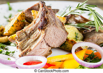 Grilled rack of lamb with fried potatoes and fresh vegetables