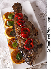 grilled rainbow trout with vegetables close-up. vertical top view